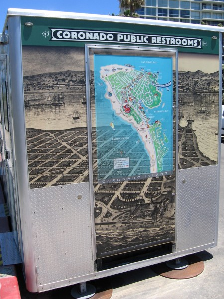 Old and new maps of Coronado Island on a portable restroom.