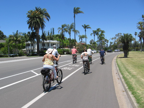 Bicyclists ride down Glorietta Boulevard, part of the Bayshore Bikeway around San Diego Bay.