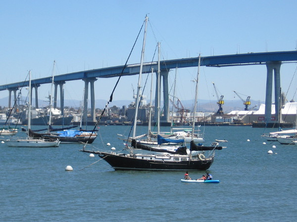 Boats moored between Coronado and the bridge. San Diego's shipyards can be glimpsed on the other side of the bay.