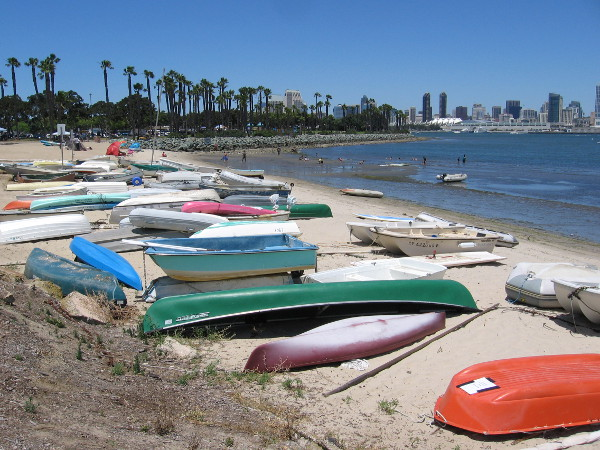 Colorful boats piled on the sand near Coronado Tidelands Park.