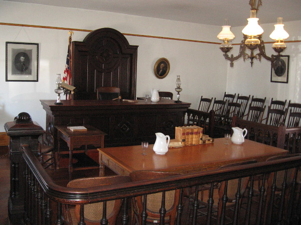 The self-guided tour begins in the courtroom, behind the store. Originally a granary whose brick walls didn't stop rats, at different times the room served as school, church, ballroom and billiard hall.