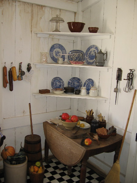 Many of the dishes and utensils are original. Prepared food would be passed through to the adjacent dining room.