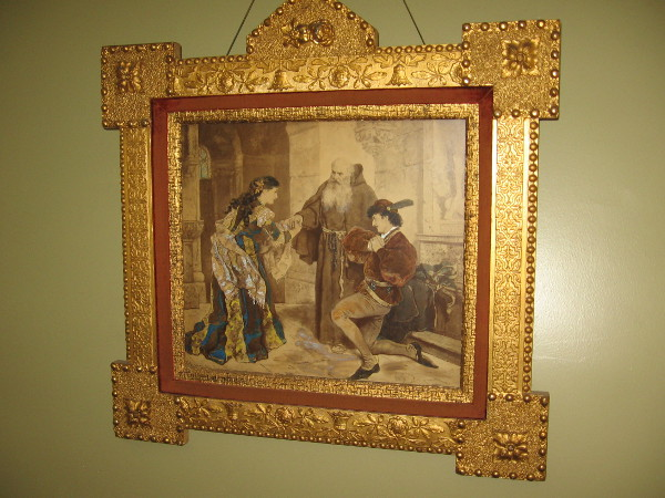 Painting in the theater from Shakespeare's Romeo and Juliet. On the opposite wall hangs a painting from Othello.
