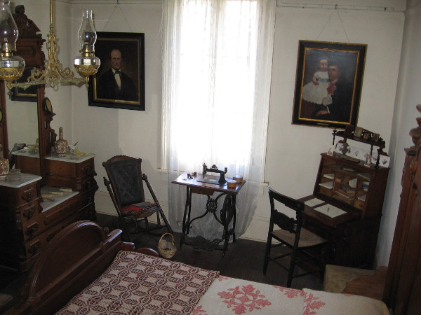Photo of Thomas and Anna Whaley's master bedroom. According to the self-guided tour info, the walnut bedroom set is in the Renaissance Revival style. The writing desk was Anna's.