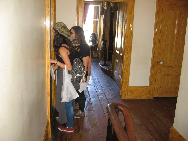 Visitors look for ghosts in the children's bedroom. The theater is straight ahead.
