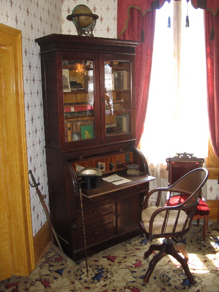 The adjacent study with desk and bookcase. During his time in San Diego, Thomas Whaley held many positions, including merchant, city clerk, notary public, realtor and railroad secretary. That sword was actually a prop used by the Tanner Troupe during their performances in the theater upstairs.