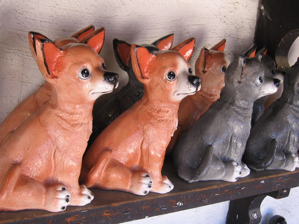 Pottery pooches on a shop's shelf in Old Town.