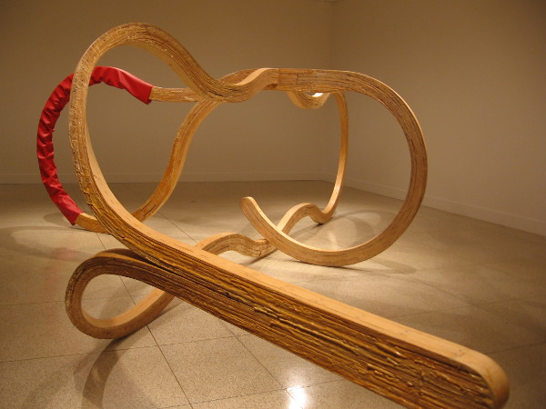 Richard Deacon enjoys playful, suggestive language and has called this huge piece Double Talk. The viewer can decide what is meant.