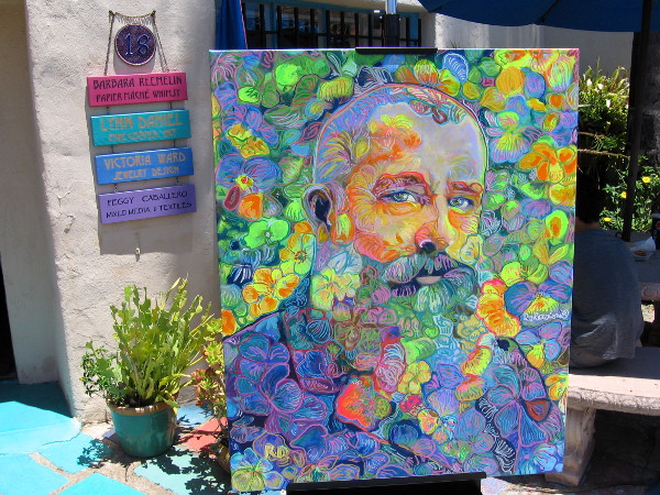 In Spanish Village I was stopped in my tracks by this amazing painting by artist RD Riccoboni. An image of Claude Monet composed of flowers!