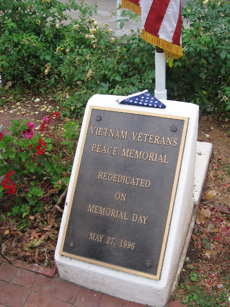 A folded flag above the plaque marking the Vietnam Veterans Peace Memorial in Balboa Park.