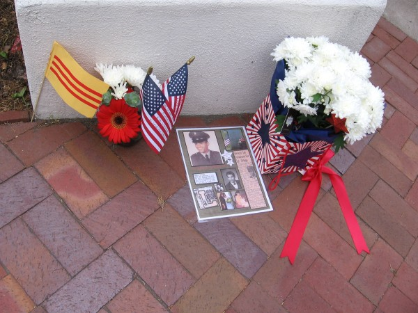 Flags, flowers and photos. A loved family member.