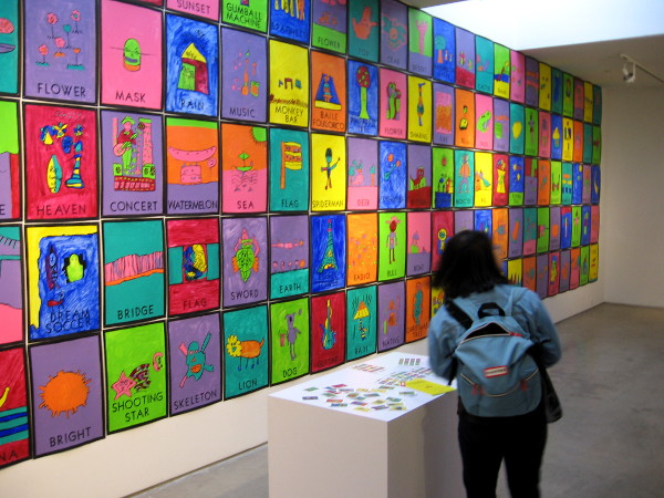 Visitor at San Diego Art Institute in Balboa Park checks out Loteria Reinvented!