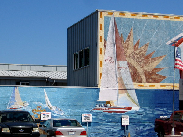 Sailboats are painted on the side of the building at 2608 Shelter Island Drive in San Diego.
