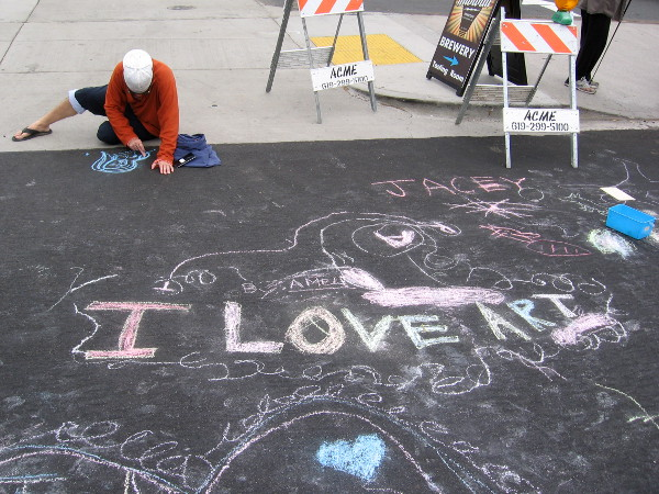 Someone tries their hand at creating with chalk during the Ocean Beach Street Fair. I Love Art.