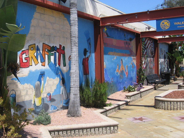 A small park located on the 8300 block of La Mesa Boulevard contains murals that celebrate people helping people.