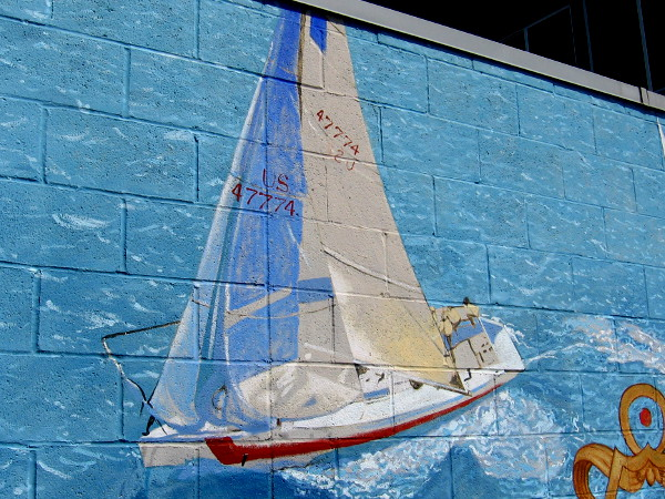 The beautiful mural shows sailboats racing on the blue ocean.
