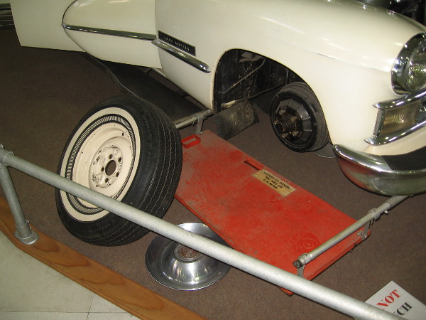 A passenger on the moving car could stand on this projecting platform to change a tire! The axles are drilled, so tires can be inflated while turning!