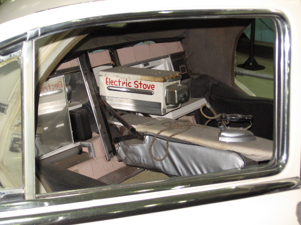 Not many cars feature an electric stove and ironing board!