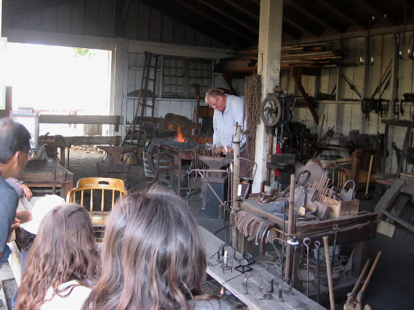 This friendly blacksmith provided lots of fascinating information. Visitors watch with interest as he works to create a pot holder.