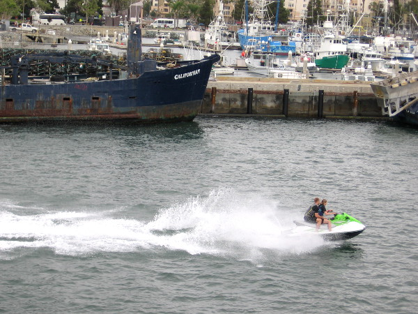 Someone enjoys recreating on San Diego Bay as we pass Tuna Harbor. Tourism and commercial fishing rely on San Diego's harbor.