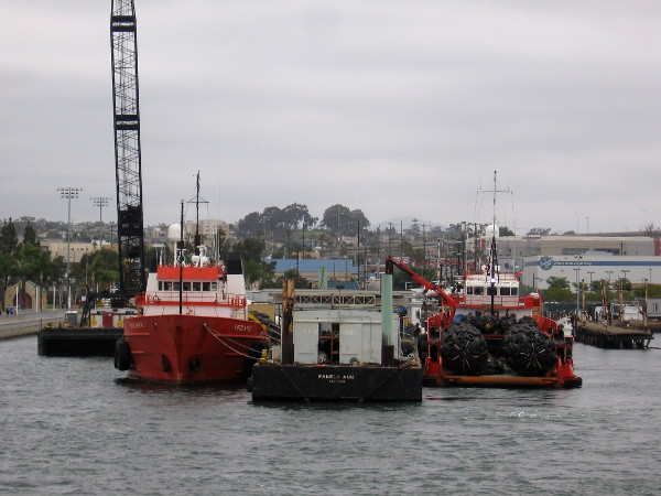 Docked south of the Tenth Avenue Marine Terminal, beside the Cesar Chavez Park pier, are the vessels of Pacific Tugboat Service.