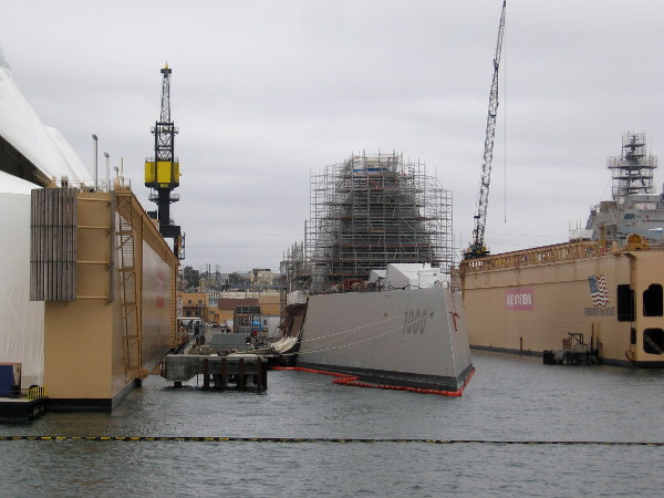 This is a new type of stealth Navy ship--a guided missile Zumwalt-class destroyer. DDG-1000 is the first of its class. Its radar image is similar to that of a fishing boat.