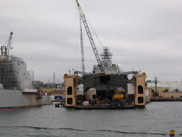 Another vessel is being worked on at the BAE Systems San Diego shipyard. You can see floating oil spill containment booms in many of these photos.