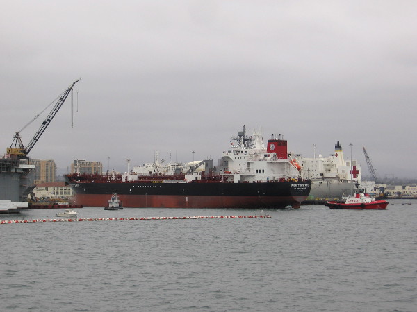 As we continue into the South Bay, we see a large ship is being moved away from the shore by tugboat.