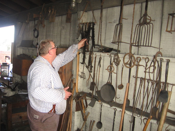 The gentleman showed me some devices used to suspend pots over a fire. Everything on this wall was made by local members of blacksmithing clubs and organizations.