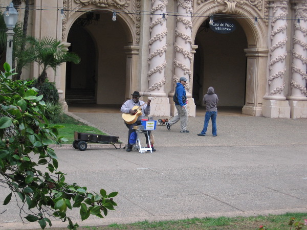 Big Slim plays guitar by the Casa del Prado.