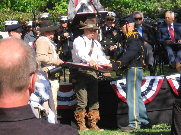 Folding of the flag. Each of the thirteen folds is invested with a special meaning.