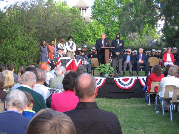 Four American veterans on stage are honored and made honorary members of the Mormon Battalion.