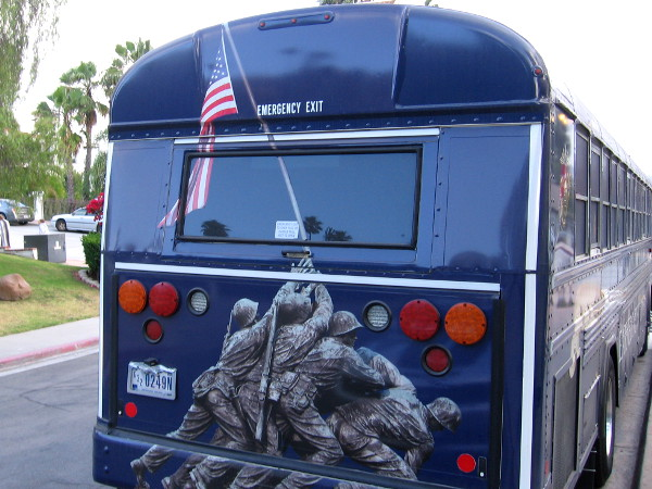 The United States Marine Corps bus contains an image of the flag being raised during the Battle of Iwo Jima.