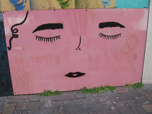 Pink face with closed eyes.
