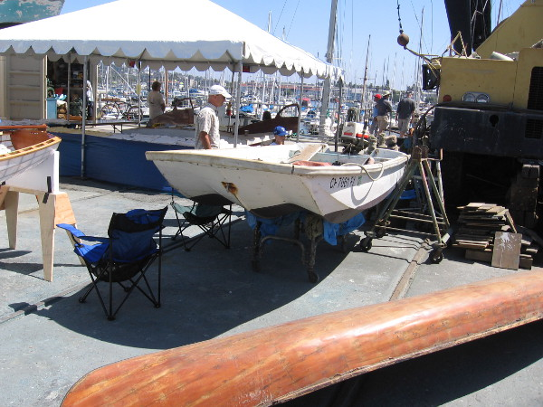 Various boats in the boatyard are being worked on. Some displays show the public how wooden boats are made.