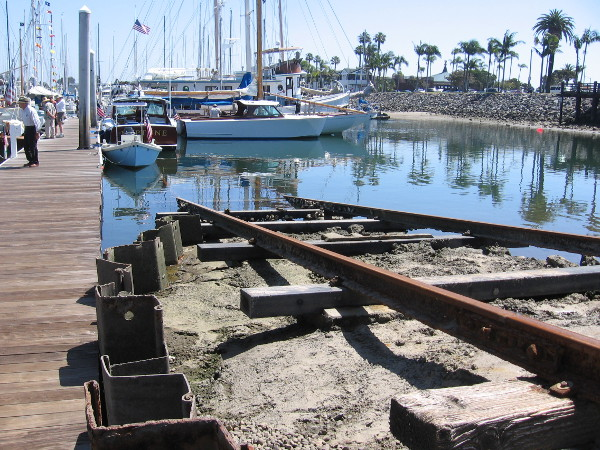 Boats can be moved into and out of the water using these old rails and a wheeled platform.