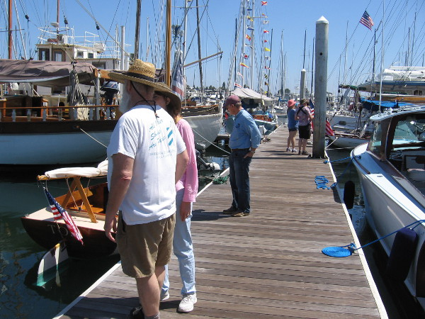 Visitors to the San Diego Wooden Boat Festival check out a variety of interesting vessels.