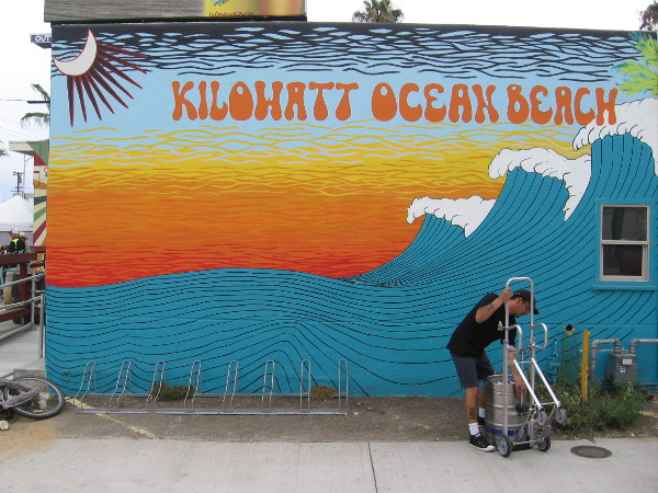 Meanwhile, another keg of beer is arriving in an alley by the Kilowatt Ocean Beach mural.