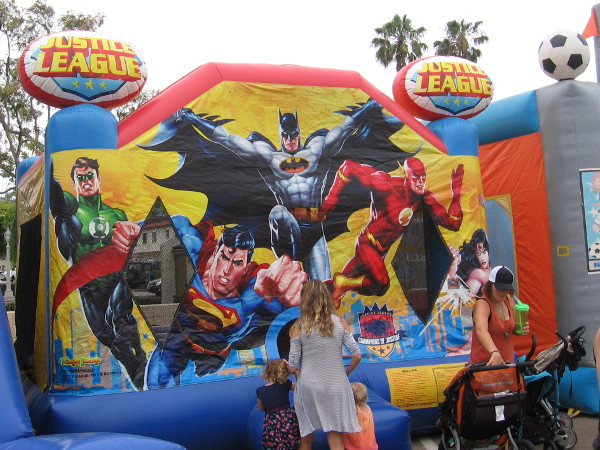 Kids enjoyed a bounce house that featured comic book art.