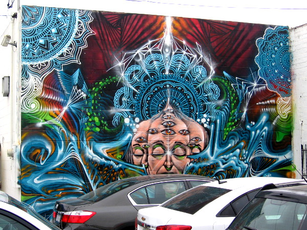 Spiritual revelation is suggested by many eyes and mandalas in an Ocean Beach mural. This cool street art can be experienced in a little-visited alley. The whole can be glimpsed from any place where you stand.