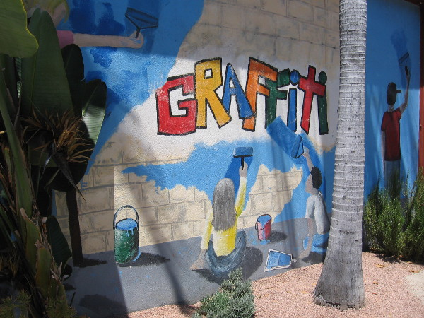 One mural in the park shows youth working to clean up graffiti.