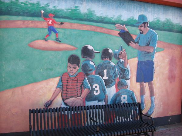A volunteer coach teaches baseball.