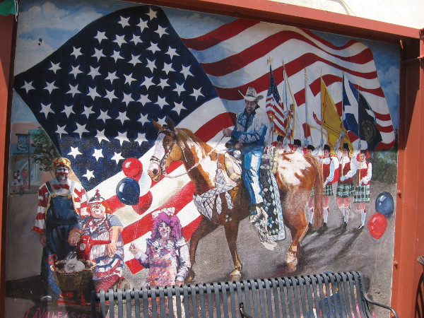 I believe this mural depicts the annual La Mesa Flag Day Parade.