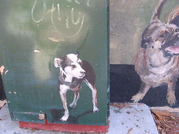 Painted dog on a utility box seems to have jumped out from the bustling mural.