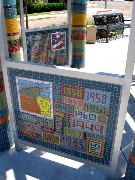 Closer photo of The Lookout at Legacy Park. Eight mosaic panels made of tile show historical events in La Mesa from 1912 to 2012.