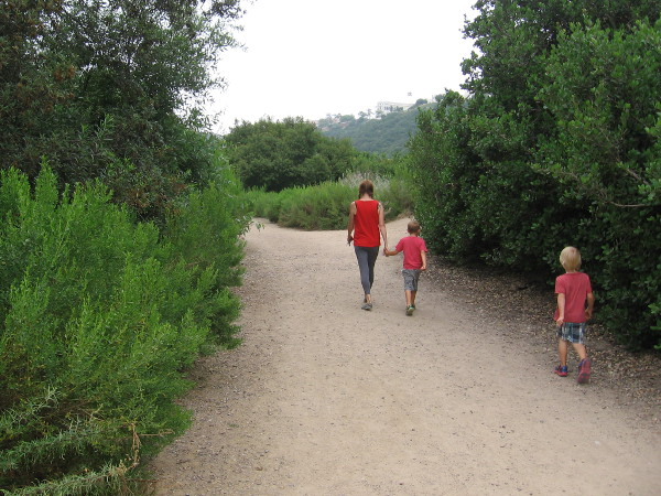A family heads into Tecolote Canyon to explore nature.