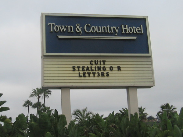 Town and Country Hotel sign reads: CUIT 5TEALING O R LETT3RS