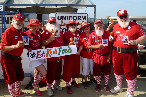 Real Santas United to End Childhood Obesity pose for the judges in the Uniform Contest at 2017 OTL. Photo courtesy Bill Swank.