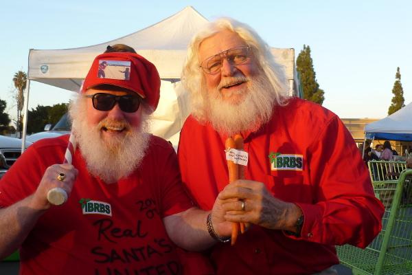 "Photo of Baseball Santa Bill Swank and Richard ""Sustainable Santa"" Eckfield at the Linda Vista Farmers Market last December. Photo courtesy Bill Swank."