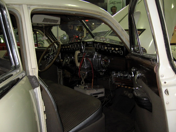 A look inside the amazing car through the front passenger side door.